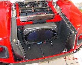 Add a Jensen MXA6BA 200 Watt Powered Sub-Woofer Marine Speaker.<br />And you will enjoy the audio system as you power down the trail.
