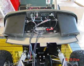 Here we are wiring up the dash. There are three wiring harness on the vehicle, #1 is the 48/vac harness for the motor and the Curtis Controller, #2 12vdc for the standard functions of the vehicle such as lights, tail lights & brake lights. #3 is a 12vdc for the optional features such as the audio system, sub-woofer and phone jack.
